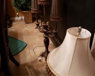 Lamps with shades trimmed with tassels