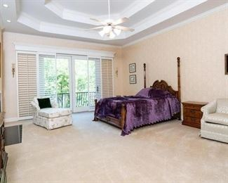 Master bedroom with king bed, chaise lounge, chair, night stands, dressers.