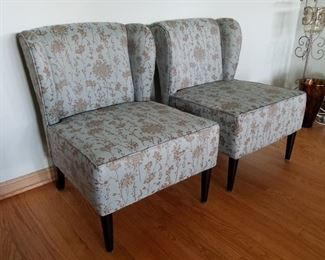 "Modern style, Pier 1, modified wing back, armless chairs.   23.5"" wide x 32"" tall."