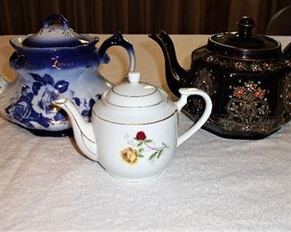 "(LEFT) BLUE ""IRON STONE VICTORIA WARE"", (RIGHT) BLACK FLORAL ""ENGLAND AORIATIC GIBSONS & SONS"" TEAPOTS"