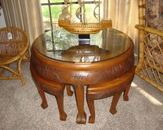 SPLENDID WOOD CARVED TEA TABLE WITH NESTING STOOLS (SEE NEXT PHOTO)