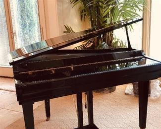 Small scale player baby grand piano