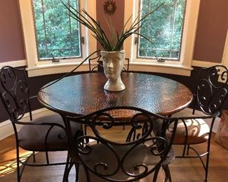 Hammered copper and iron dining table