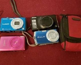 Four Digital Cameras and Case