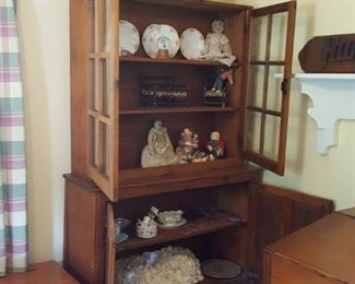 Primitive cabinet, carved wooden swan, primitive dolls and more
