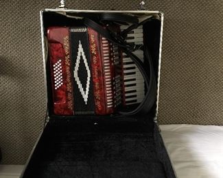 Accordion with case. Very old