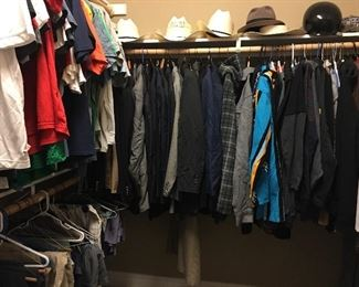 This closet is full of men's clothing. Many are custom shirt & suits range from 40-42R