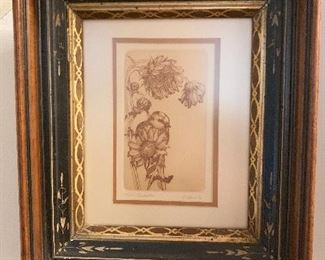 Antique frame with a sepia tone lithography bird print.