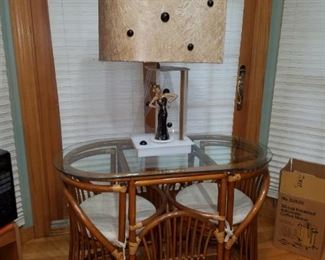 Great table and 2 chairs and a fabulous lamp with rotating lady