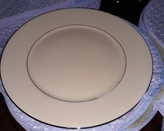 Lennox Fine China Set.    Service  for 12 people.  a five piece place setting.  Plus serving pieces.  In Beautiful condition.  Silver bands of  trim on the china.