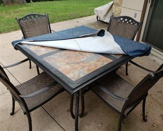 Iron and tile top patio table and four chairs