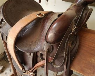 Western cowboy saddle with rifle scabbard. Over 65 years old and looks new