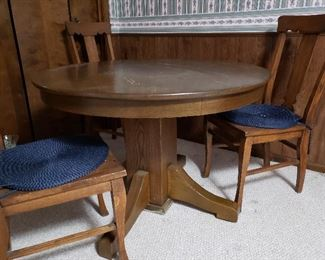 Heavy antique oak round dining table plus four chairs