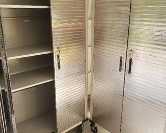 Two stainless steel rolling storage cabinets