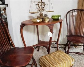 Antique Windsor chairs and carved lion's head entry table