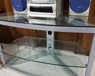 Glass media stand