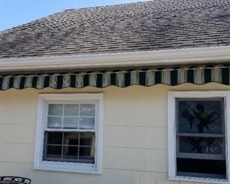 Newer electric awning with remote control. Approx. 14 ft. wide; extends approx. 12 ft.