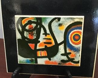 "Joan Miro tile ""Portrait of a Young Girl"". Paper label. 4""x5"""