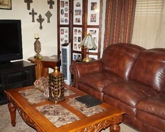 leather couch, coffee table, side tables, Flat Screen TV, TV cabinet
