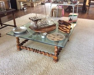 Glass and turned base coffee table