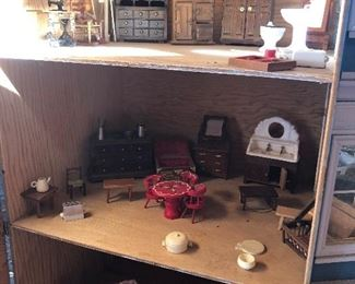 Doll house filled with furniture