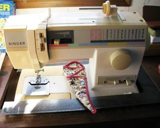 Singer sewing machine   BUY IT NOW $ 85.00