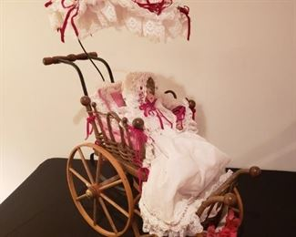 Collector doll in antique buggy