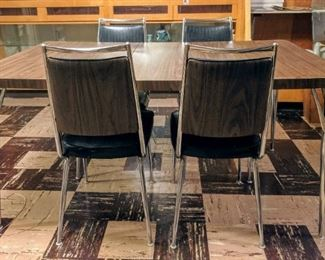 update! WE FOUND ALL 6 CHAIRS!! Fabulous Chrome Dinette set with Faux Bois (haha fake wood) vinyl & black. EXCELLENT.  Shown with leaf.
