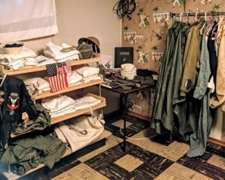 TWO GENERATIONS of US NAVAL UNIFORMS WWI AND WWII. inc coats, hats,  sea bags, mummy bags and books.  48 star flags.  A few Vietnam era items.