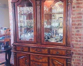beautiful lighed china cabinet with even finer crystal