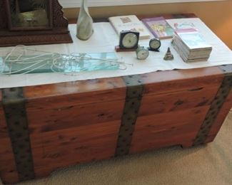 Cedar Chest- large cedar chest with wheels and metal banding, inside has removable box