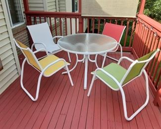 Color patio set with 6 chairs only for showing here plus two matching recliners