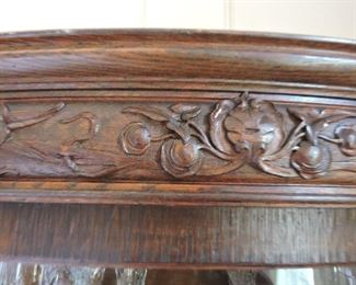 Fret work on Bent Glass Curio Cabinet