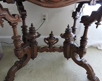 Parlor side table marble top very ornate. Fret work of parlor side table