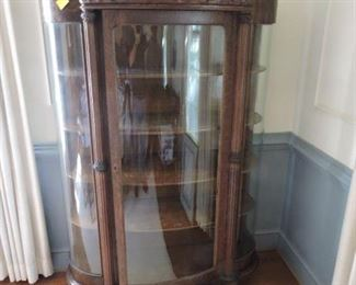 Bow front Bent Glass curio Cabinet with ornate fret work