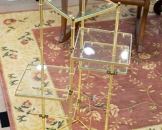 We have two gold, glass tables/displays - this one and a round one.