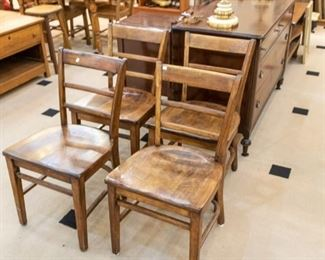 Several wood chairs...