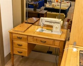 Several sewing machines in this sale!