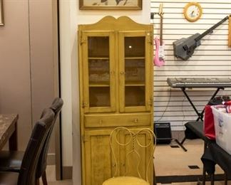 What an adorable cabinet!  The vintage bird picture is nice too:)