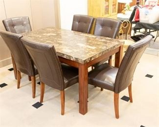 Great Table & Chairs set - perfect for a family!  Vinyl chairs to wipe clean, and durable easy to care table top.