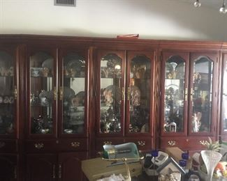 This china hutch is 5 individual lighted pieces.  You can buy one or all.  Solid wood beautiful.