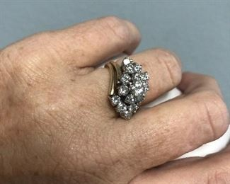.5c diamond surrounded by 10 diamonds in a 14k setting $2,500