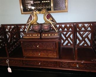 Ornate shelf with small drawers