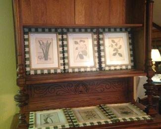 Antique display cabinet; fine-looking framed botanical prints