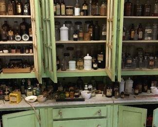Pharmacy shelf glass and old Loyola specimines