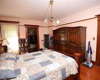 Victorian armoire, kingsize head and foot board bed, kenmore vacuum and large collection of books