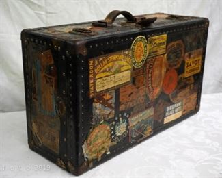 antique traveling trunk with world's stickers