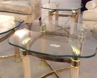 We have four of these Grecian looking glass top tables, all in great shape $30.00 each
