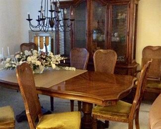 Gorgeous table with 8 cane  back and velveteen cushions , table has leaf and full set of protective pads, cushions could easily be recovered