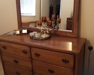 Dresser with mirror $150.00, full bed in previous picture $185.00 includes wood frame and mattress set